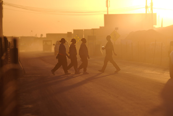 Troops going about their business in the dusty afternoon.
