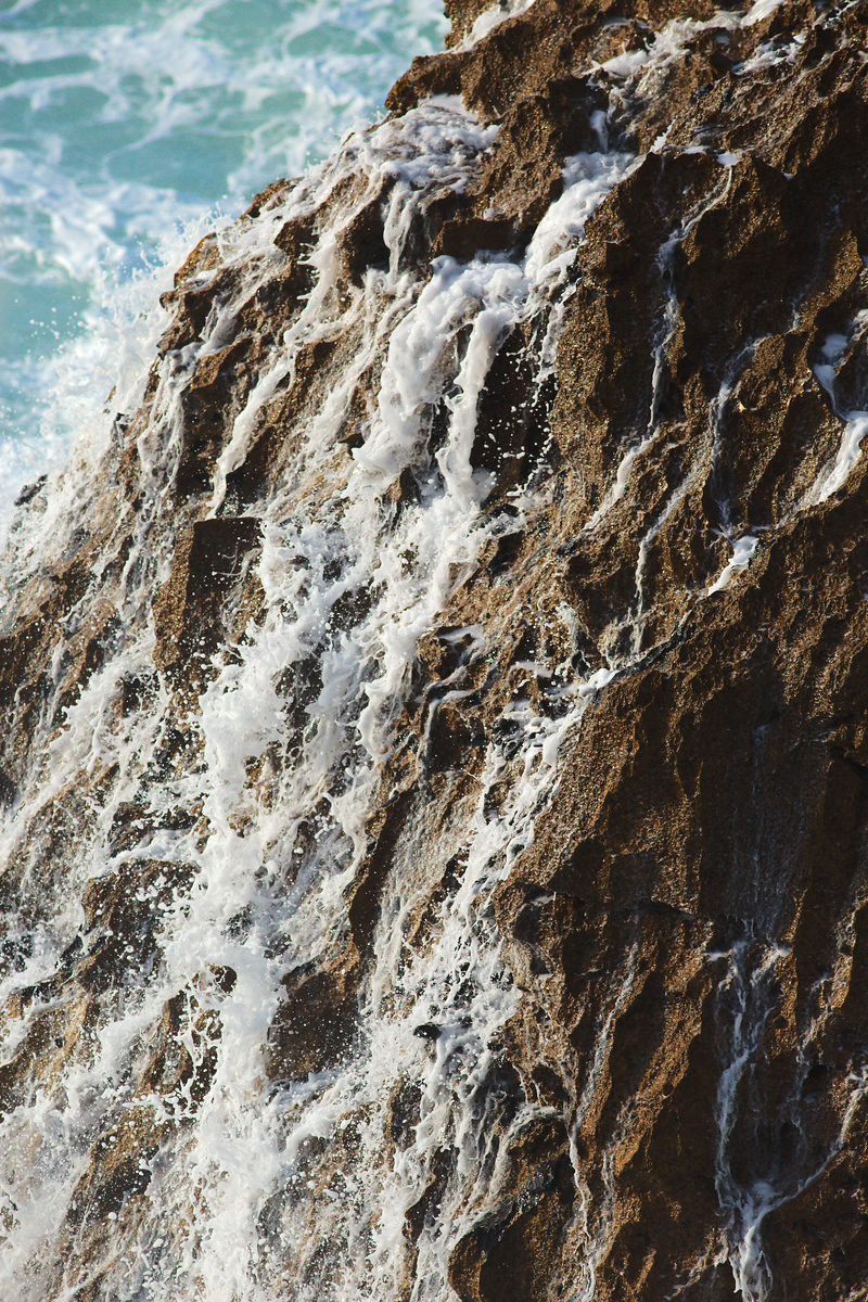 Water runs of a rock after being struck by a wave [800x1200][oc]