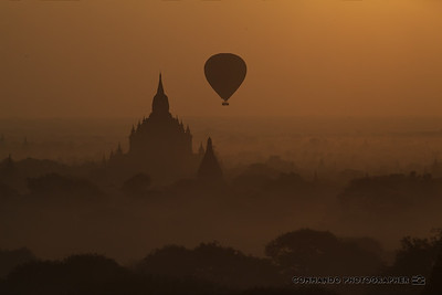 A balloon glides over the horizon.